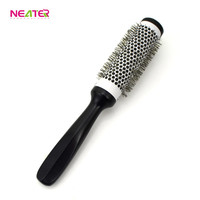 Ningbo hard nylon bristle round ceramic hair brush with the wood handle