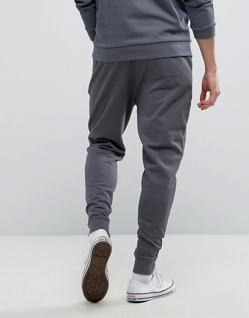 KY jogger pants men grey Drawstring waistband With metal tips and eyelets Zipped side pockets Fitted cuffs Tapered Joggers