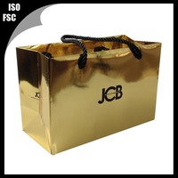 Shiny gold hot stamped gift paper bag for wine bottle