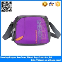Factory direct sales nylon purple cheap school messenger bag for kids