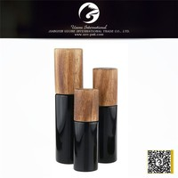 Wholesale black cosmetic lotion bottle glass