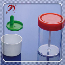 Disposable stool sample container with spoon