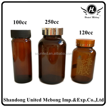 empty vitamin pills tablet amber glass bottle with golden cap