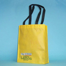 2015 custom logo print light yellow color non woven cloth shop carry packaging bag