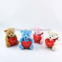 Cute teddy bear with heart plush toy