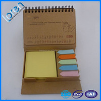 coil winding sticky notes set in brown kraft paper box with calendar