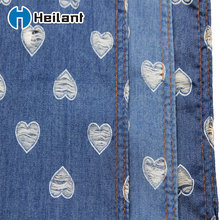 wholesale price hollow warp design cotton material heart printed raw denim fabric
