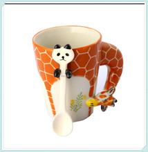 Giraffe Style ceramic coffee mug with spoon in mug
