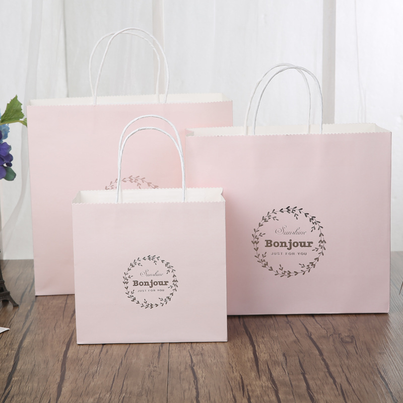 Wholesale hot stamping kraft white personalised gift paper bag shopping bag brand With Paper String Handles