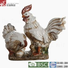 White ceramic chickens and rooster sculpture