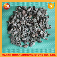 colorful natural crushed crystal and cobble stone in many different sizes