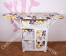 Solid wood folding ironing board with Simple prints cloth and willow basket and storage cabinet
