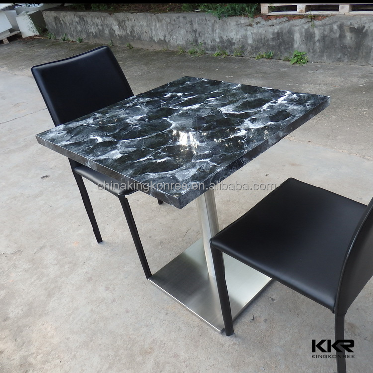Artificial stone top round pedestal dining table