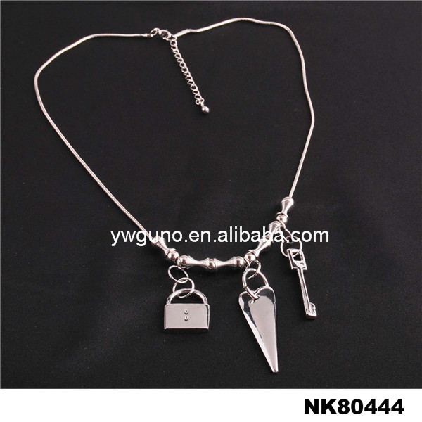 custom wholesale alibaba silver metal chain with alloy bag heart and key pendant necklace