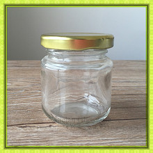 Cheap round 100ml clear hermetic mini glass storage jar with golden metal lid for jam or honey