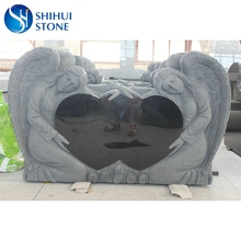 Granite monument heart shaped double angel headstone