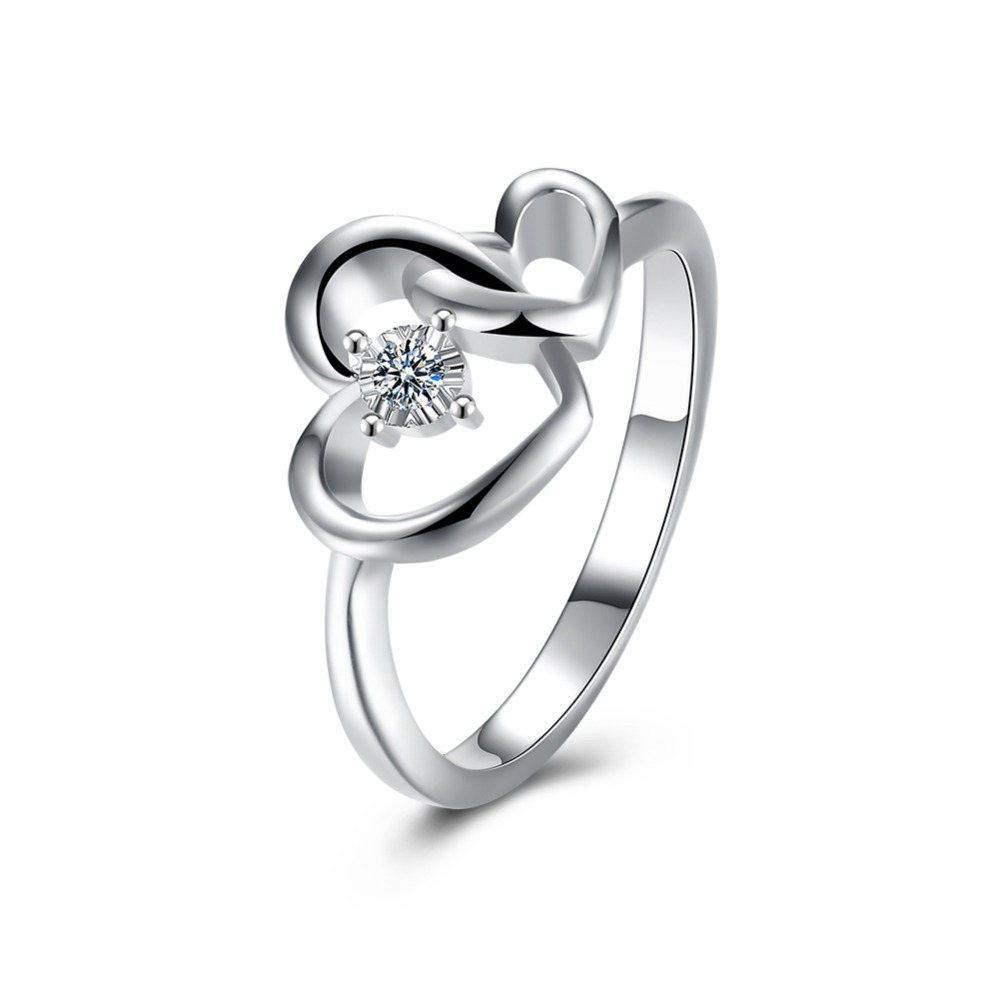 Heart linked to heart rings premier jewelry ring