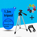 There segment camera tripod with aluminum alloy,with a phone holer and bluetooth