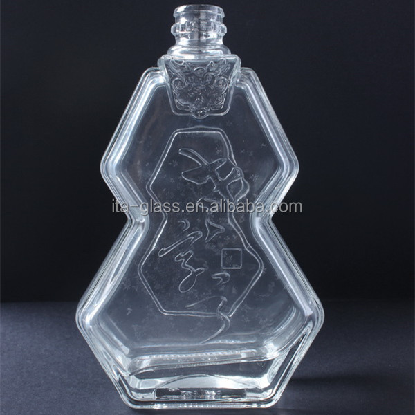 High quality factory wholesale 450ml fancy custom design eco-friendly empty clear machine made glass bottle for liquor beverage