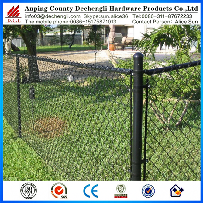 Black vinyl coated chain link fence separating boundary
