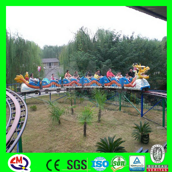 Carnival ride amusement park children small roller coaster train slide dragon