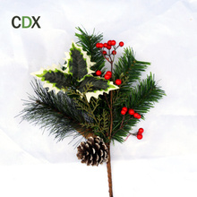 Red berries & pine cones decorated pine needle Christmas pick