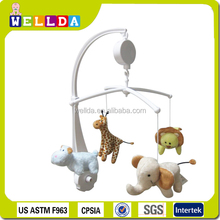 Plush animal toy hanging on baby crib musical mobile