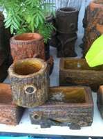Handmade wooden style flower pot made from recycling material
