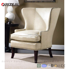 Beautiful French style wingback hotel chair upholstered in white leather with nailhead trim