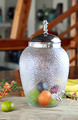 blown uneven surface and blur clear glass beverage dispenser