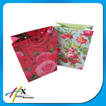 fashion design handmade paper bags hard paper packaging bags with long handles