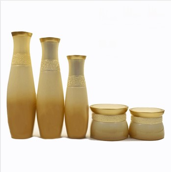Wholesale Luxury Graident Gold Cosmetic Glass Bottle and Jar for packaging