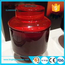 Red candle jar with red glass lid blue candle holder and glass lid