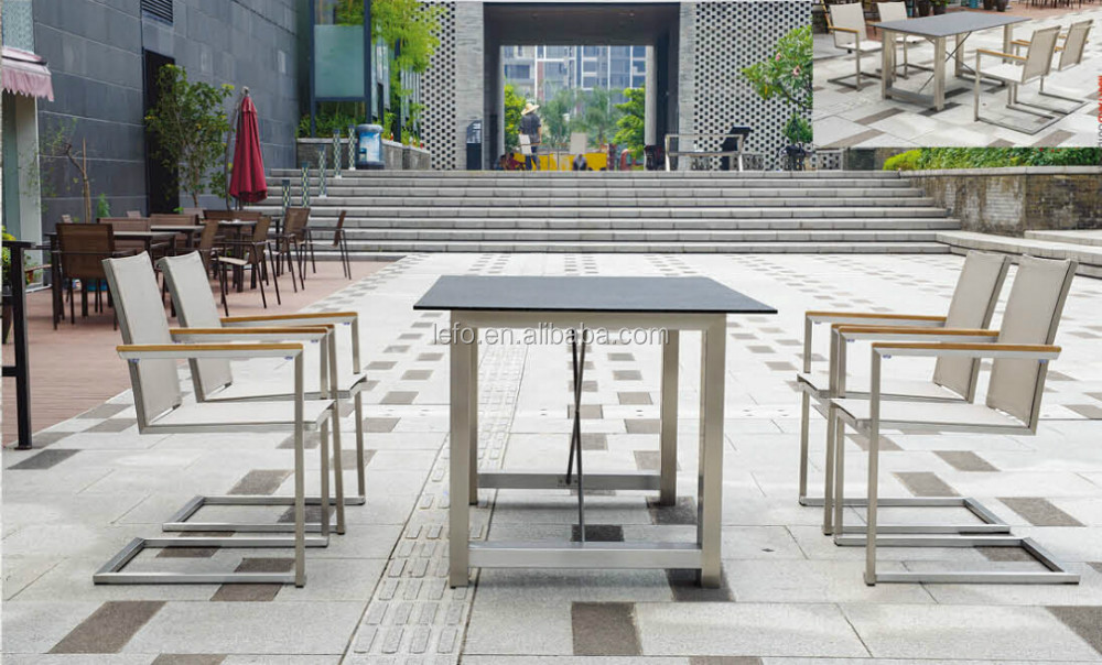 new design spray stone glass outdoor dining table and chairs set