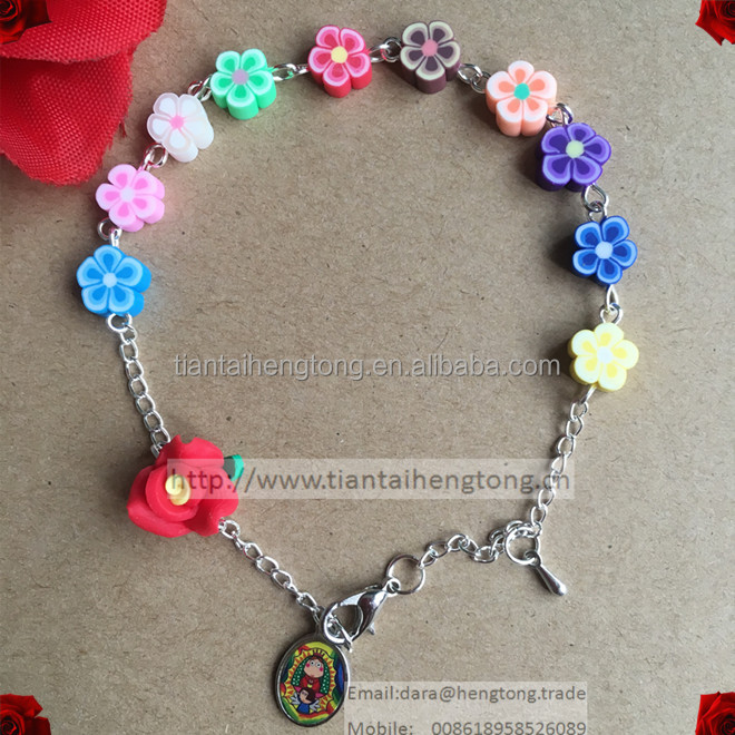 Best selling soft ceramic flower beads religious rosary bracelet whit Guadalupe epoxy alloy pendant, polymer clay bead bracelet