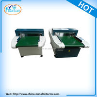 Conveyor belt clothing metal detector