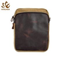 Hot selling comfortable long shoulder strap leather small messenger man waterproof sling bag canvas cross body bags