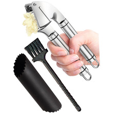 Amazon Stainless Steel Garlic Press and Peeler Set, Stainless Steel Mincer and Silicone Tube Roller and Cleaning Brush.