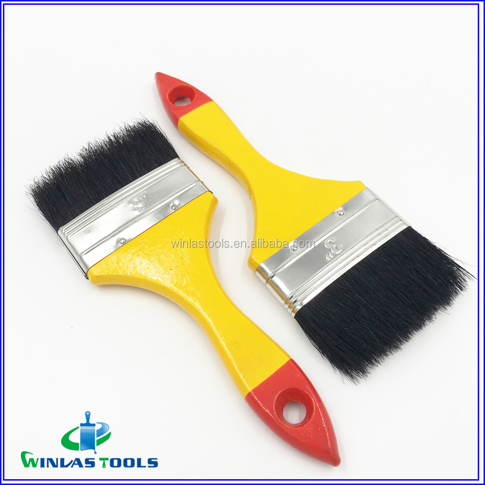 black hair yellow wooden handle paint brush