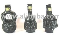 Coca liqueur ceramic bottles of Peruvian culture, containing coca leaf liqueur and maca