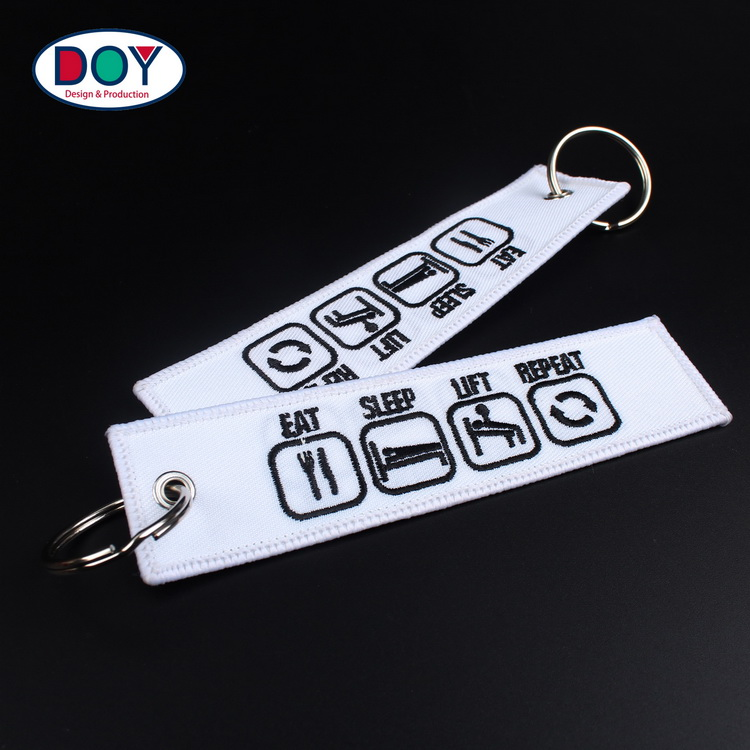 China Manufacturer Design Custom 3D Branded Logo Name Embroidery Tag Key Chains for Promotional