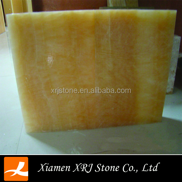 China cheap polished sunny yellow onyx marble prices tiles on sale