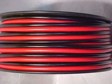 red and black jacket professional ofc speaker cable