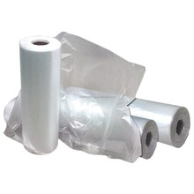 Dry clean perforated clear poly plastic garment/laundry/clothing bags on a roll