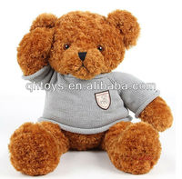 Brown teddy bear toy wearing knitting t-shirt