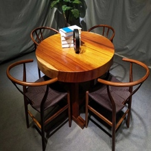 Stainless steel dining table with leather chair