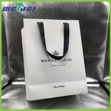 White shopping gift paper bag with logo print, creative cute paper bag