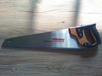 hand saw with wood and rubber handle