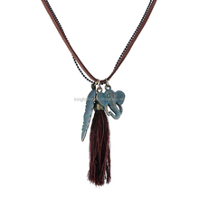Patina green distressed alloy elephant and leaf pendant dual wrap suede leather vintage tassel necklace