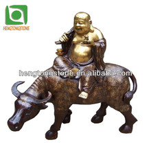 Cast Bronze Buddha Riding An Ox Statue